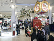 Shoppers inside Macy's at Christmas time in NYC Royalty Free Stock Photo