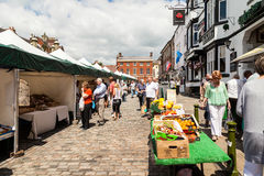 Shoppers at Leek's open air market. Leek, Staffordshire Moorlands, England, U.K - June 21 2014 : Shoppers at Leek's open air market Leek  is an ancient Royalty Free Stock Photography