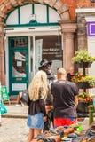 Shoppers at Leek's open air market. Leek, Staffordshire Moorlands, England, U.K - June 21 2014 : Shoppers at Leek's open air market With man in face mask Stock Image