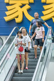 Shoppers at Livat Shopping Mall, Beijing, China. BEIJING-AUG. 4, 2106. People on escalator in shopping mall. China's economy boosted by middle class wealth Royalty Free Stock Image