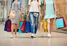 Shoppers with long legs Stock Images