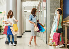 Shoppers looking in mirror Royalty Free Stock Photos