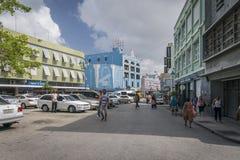 Shoppers in Lower Broad Street, Bridgetown, Barbados. BRIDGETOWN, BARBADOS, 21 DECEMBER 2015 - Colourful buildings and shoppers  in Lower Broad Street Royalty Free Stock Images