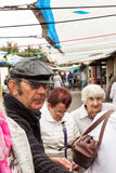 Shoppers at open air market. Gas Works Lane, Prestatyn, Denbighshire, Wales., U.K - May 20 2014 : Shoppers at open air market. Market trader in sunglasses in Stock Photo
