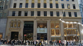 Shoppers outside Crown Building, Fifth Avenue, New York stock image