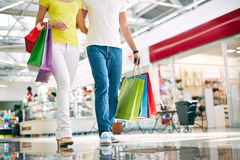 Shoppers with paperbags Stock Images