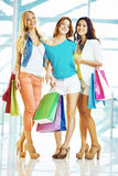 Shoppers with paperbags Royalty Free Stock Photos