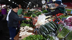 Shoppers at Queen Victoria Market in Melbourne, Australia. MELBOURNE, AUSTRALIA- AUG 27: Shoppers at Queen Victoria Market on August 27, 2015. It is a major royalty free stock photos