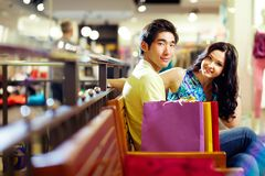 Shoppers at rest. Young people enjoying the break between shopping sessions Stock Image