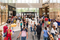 Shoppers Rush In Luxury Shopping Mall Interior. BUCHAREST, ROMANIA - JUNE 06, 2015: Shoppers Rush In Luxury Shopping Mall Interior Royalty Free Stock Image