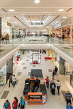 Shoppers Rush In Luxury Shopping Mall Interior Royalty Free Stock Images