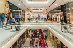 Shoppers Rush In Luxury Shopping Mall Interior Stock Photos