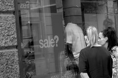 Shoppers and sale in all store Stock Images