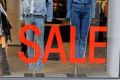 Shoppers and sale in all store Stock Photos