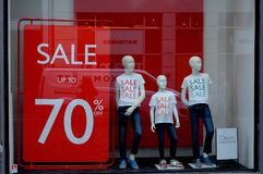Shoppers and sale in all stores Royalty Free Stock Image