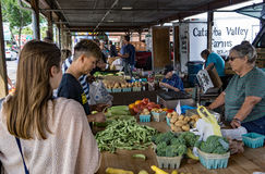 Shoppers at the Salem Farmers Market. Salem, VA – July 27th: Shoppers buying fresh picked vegetables at the Salem Farmers Market located on Main street Stock Photo