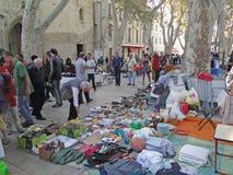 Shoppers search for bargains. AVIGNON, FRANCE - OCT 2:Shoppers search for bargains at a weekly flea market on Oct 2, 2011, in Avignon, France Stock Image