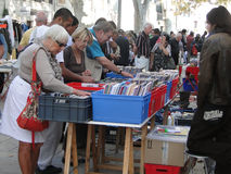 Shoppers search for bargains. AVIGNON, FRANCE - OCT 2:Shoppers search for bargains at a weekly flea market on Oct 2, 2011, in Avignon, France Stock Photography
