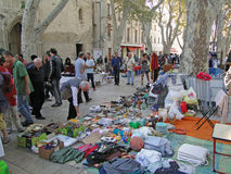 Shoppers search for bargains at a weekly flea market. AVIGNON, FRANCE - OCT 2:Shoppers search for bargains at a weekly flea market on Oct 2, 2011, in Avignon Royalty Free Stock Images