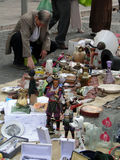 Shoppers search for bargains at a weekly flea market. AVIGNON, FRANCE - OCT 2:Shoppers search for bargains at a weekly flea market on Oct 2, 2011, in Avignon Stock Photo