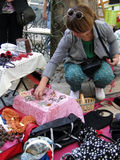 Shoppers search for bargains at a weekly flea market Stock Photos