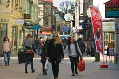 Shoppers with shopping bags busy shopping street Royalty Free Stock Photo