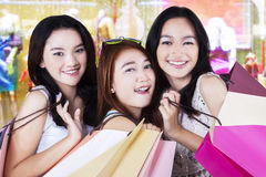 Shoppers with shopping bags in the mall Stock Photos