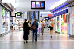 Shoppers at shopping center 2. Shoppers at shopping center, motion blur Stock Image