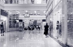 Shoppers at shopping center. Tint blue Stock Photography