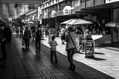 Shoppers shopping in Chelmsford England. 01/09 - Shoppers walking past high street shops in a Chelmsford Shopping centre during the summer of 2015 in England stock photography
