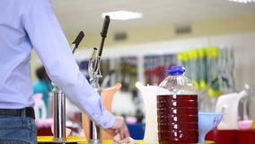 Shoppers in the store choosing engine oil. motor oil in auto store stock video