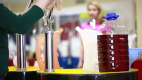 Shoppers in the store choosing engine oil. motor oil in auto store stock footage