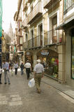 Shoppers in streets of historic Toledo, Spain Stock Photo