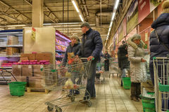 Shoppers in the supermarket Stock Images