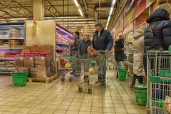 Shoppers in the supermarket Stock Photos