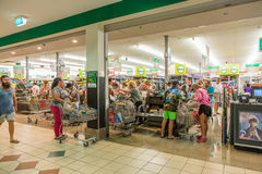 Shoppers in supermarket stocking up before Cyclone Debbie on Aus Stock Images