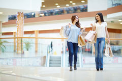Shoppers talking Stock Photography