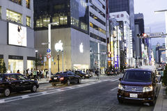 Shoppers and tourists pass by a large Apple store in Ginza in Tokyo, Japan Royalty Free Stock Image