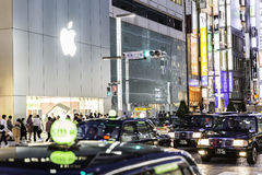 Shoppers and tourists pass by a large Apple store in Ginza in Tokyo, Japan Stock Image