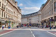 Shoppers and tourists in Regent Street. In London.Regent Street is one of the major shopping destinations in London's West End and home to many protected Royalty Free Stock Image