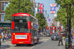 Shoppers and traffic on Oxford street Royalty Free Stock Photography