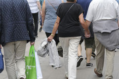 SHOPPERS AND TRAVELERS FOR SALE Stock Photo