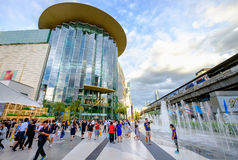 Shoppers visit Siam Paragon mall in Siam Square mall on in Bangk Royalty Free Stock Photos