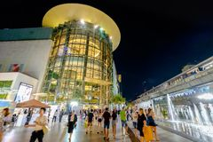 Shoppers visit Siam Paragon mall in Siam Square mall on in Bangkok, Thailand. royalty free stock image