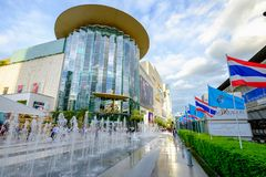 Shoppers visit Siam Paragon mall in Siam Square mall on in Bangkok, Thailand. stock photo