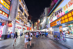 Shoppers and visitors crowd the famous Dongmen Pedestrian Street. Dongmen is a shopping area of Shenzhen. SHENZHEN, CHINA-APR 08, 2017: Shoppers and visitors Royalty Free Stock Photo