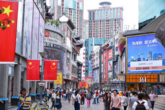 Shoppers and visitors crowd the famous Dongmen Pedestrian Street royalty free stock photo