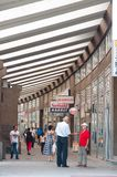 Shoppers walk along covered shopping street in Novi Pazar, Serbia. NOVI PAZAR, SERBIA - 26 July: shoppers walk along AVNOJ-a covered shopping street on July 26 stock images