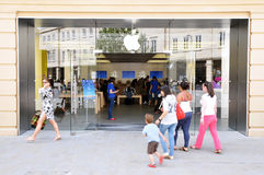 Shoppers Walk to an Apple Store. London - JULY 28: Shoppers enter an Apple store as major retail group DSG International predict the electronics giant's iPad Royalty Free Stock Image