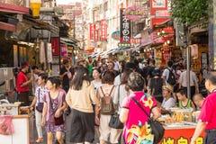 Shoppers walking through Danshui Pedestrian shopping area Royalty Free Stock Photography